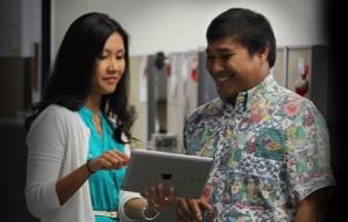 Man and woman looking at an ipad